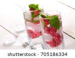 raspberry fruit water with ice...   Shutterstock . vector #705186334