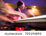 musician plays keyboards in a... | Shutterstock . vector #705194893