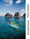 local tahitian man canoeing for ... | Shutterstock . vector #705196054