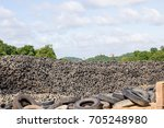 heap of old tires  in recycling ...   Shutterstock . vector #705248980