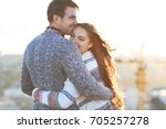 young man and woman embrace and ... | Shutterstock . vector #705257278