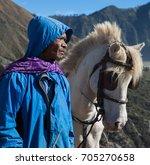 mount bromo indonesia august 13 ... | Shutterstock . vector #705270658