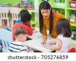 asian female teacher teaching... | Shutterstock . vector #705276859