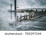 water coming over the streets... | Shutterstock . vector #705297244