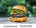 brioche bun with burger  fried... | Shutterstock . vector #705316990