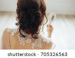 young brunette is looking in... | Shutterstock . vector #705326563