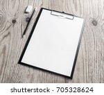 clipboard with blank letterhead ... | Shutterstock . vector #705328624