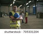 worker posing in factory... | Shutterstock . vector #705331204