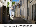 old road with houses in arles ... | Shutterstock . vector #705332539