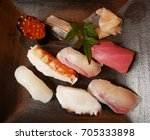 Small photo of Sushi topped with variety raw ingredient including fish, ikura or salmon roe, shrimp, ika or squid, and tako or octopus