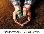 Small photo of Hands with fertile soil and euro money banknotes, female farmer handful of cultivated land that makes profit and steady income from sustainable agricultural activity like organic growth of crops