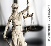 Small photo of Scales of Justice symbol - legal law concept image