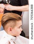 little boy getting haircut by... | Shutterstock . vector #705366388
