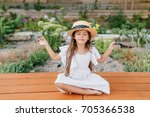 pretty brunette female kid in... | Shutterstock . vector #705366538