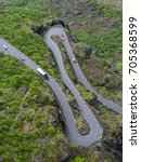 Overhead view of hairpin bends on narrow Trollstigen mountain road in Norway - stock photo