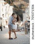 happy couple walking by sea.... | Shutterstock . vector #705371506