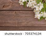 white flowers of jasmine on... | Shutterstock . vector #705374134