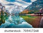 Stock photo boat hut on braies lake with seekofel mount on background colorful autumn sunrise of italian alps 705417268