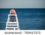 beach lifeguard on duty  | Shutterstock . vector #705417373