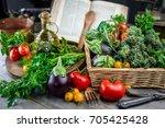 ingredients and cookbook  | Shutterstock . vector #705425428