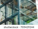 modern green glass elevator for ...   Shutterstock . vector #705429244