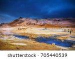 icelandic geyser vapors and... | Shutterstock . vector #705440539
