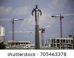 Small photo of Bronze monument, Gagarin, Yuri, Moscow, Gagarin Square, Leninsky Prospekt, Gagarinsky district, summer, evening, Building, Construction cranes. August 20, 2017