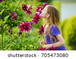 adorable little girl sniffing... | Shutterstock . vector #705473080
