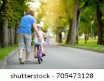 happy father teaching his... | Shutterstock . vector #705473128