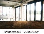 empty wooden table in front of... | Shutterstock . vector #705503224