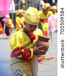 Small photo of DAVAO CITY, PHILIPPINES--AUGUST 2014:A girl joins the streetdancing competition with an earthen jar at the parade. Kadayawan is celebrated August each year to give thanks for an abundant harvest.