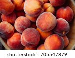 A Group Of Ripe Peaches In A...