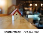 cute house wood model and free... | Shutterstock . vector #705561700