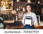 smiling asian woman barista... | Shutterstock . vector #705587959