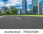 empty asphalt road front of... | Shutterstock . vector #705635284