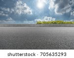 empty asphalt road in the blue... | Shutterstock . vector #705635293