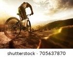 mountainbiker at sunset | Shutterstock . vector #705637870