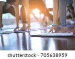group young woman doing yoga... | Shutterstock . vector #705638959