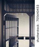 prison cell or jail cell in... | Shutterstock . vector #705640453