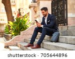 a handsome young businessman... | Shutterstock . vector #705644896