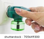 woman's hand includes electric... | Shutterstock . vector #705649300