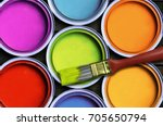 seven colorful paint with a...