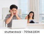 upset schoolboy touching his...   Shutterstock . vector #705661834