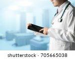 male doctor using tablet... | Shutterstock . vector #705665038
