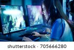 professional girl gamer plays... | Shutterstock . vector #705666280