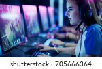 professional girl gamer plays... | Shutterstock . vector #705666364
