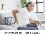 old man with back pain | Shutterstock . vector #705668263