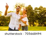 a beautiful young couple... | Shutterstock . vector #705668494