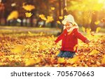 happy child girl throws autumn... | Shutterstock . vector #705670663