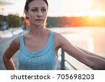 sad woman standing by the water ...   Shutterstock . vector #705698203